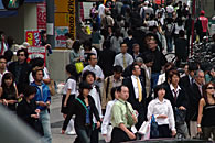 Busy people crossing the street