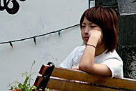 Young Tokyo woman sits and reflects